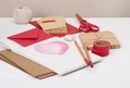 Assorted stationery items on desk Stock Photo