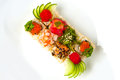 Assorted sushi roll with sesame seeds, cucumber, tobiko, chuka salad, eel, tuna, shrimp, salmon Royalty Free Stock Photo