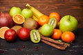 Assorted tangerine kiwi apple orange bananna and pomegranate Royalty Free Stock Photo