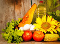 Assorted vegetables and sunflowers on a basket Royalty Free Stock Photo