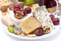 Assortment of cheeses grapes and crackers close up horizontal Stock Photos