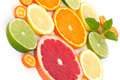 Assortment of citrus fruits grapefruit orange lemon lime and kumquat with mit leaf Stock Photos