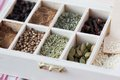 Assortment collection of spices and herb in wooden box, food Stock Images