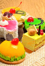 Assortment of delicious cakes pies tarts with fuits and cream on sacking Stock Images