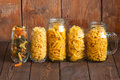 Assortment of different shapes whole grain raw Italian pasta in Royalty Free Stock Photo