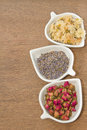 Assortment of dried flower tea in white bowl rose bud lavender and chrysanthemum Royalty Free Stock Image