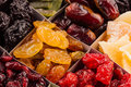 Assortment of dried fruits closeup background in square cells. Royalty Free Stock Photo