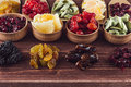 Assortment of dried fruits closeup on brown wooden background. Royalty Free Stock Photo