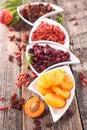 Assortment of dry fruit on wood background Royalty Free Stock Image
