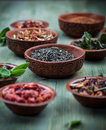 Assortment of dry tea in bowls Stock Photography