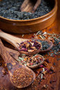 Assortment of dry tea on wooden table Royalty Free Stock Photography