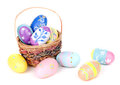 Assortment of easter eggs colorful and basket on a white background Royalty Free Stock Photography