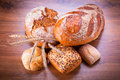 Assortment of fresh bread on wooden table Stock Photo