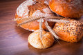 Assortment of fresh bread on wooden table Royalty Free Stock Photography