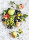 Assortment of fresh fruit grapes pears apples plums on a light background top view Royalty Free Stock Photos