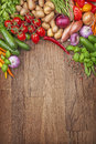 Assortment of fresh vegetables on a wooden background Royalty Free Stock Image