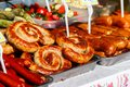 Assortment of grilled sausages for sale. Street food, fast food Royalty Free Stock Photo