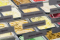Assortment  ice-cream in boxes on counter with label Royalty Free Stock Photo