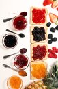 Assortment of jams, seasonal berries, plums, mint and fruits in glass jar