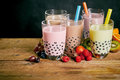 Assortment of milky bubble teas with fruit Royalty Free Stock Photo