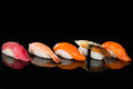 Assortment of nigiri sushi with shrimp, salmon, tuna and eel Royalty Free Stock Photo