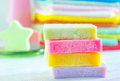 Assortment of soap and towels in different colors Stock Image