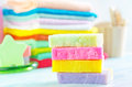 Assortment of soap and towels in different colors Royalty Free Stock Photos