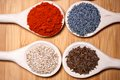 Assortment of spices with milled dried hot pepper sesame poppy seeds and caraway seeds Stock Image