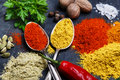 Assortment of spices seasoning on a black stone Royalty Free Stock Photo