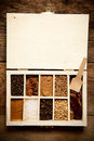 Assortment of spices in wooden box on old table top view Stock Photo