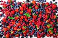 Assortment of strawberry, blueberry, currant, mint leaves. Summer berries background with copy space for your text. Top