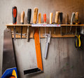 Assortment of tools hanging on the wall Royalty Free Stock Photography
