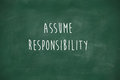 Assume responsibility handwritten on blackboard school Stock Photo