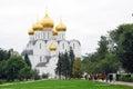 Assumption Church in Yaroslavl, Russia. People walk towards the church.