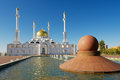 Astana mosque exterior with the fountain at the foreground in Astana, Kazakhstan.