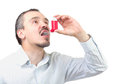 Asthma medication caucasian male inhaling aerosol spray dedication isolated on white background Royalty Free Stock Images