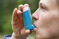 Asthma patient inhaling medication