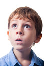 Astonished boy with expression on white background Stock Photos