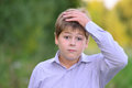 Astonished boy holding his hands behind head Royalty Free Stock Images