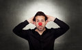 Astonished businessman with clown nose on a over gray and irregular background Stock Photography