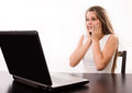Astonished girl behind a laptop Royalty Free Stock Photo