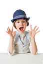 Astonished little boy looking at camera with open mouth isolated on white background Stock Photography