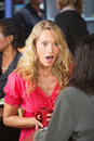 Astonished woman in cafe female talking with friend restaurant Royalty Free Stock Images
