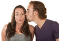 Astonished Woman Kissed by Man Royalty Free Stock Image