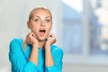 Astonished woman pretty blonde covering mouth Stock Images