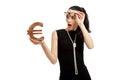 Astonished woman wearing black dress holding euro sign over white background Stock Photos