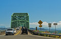 Astoria megler bridge north entrance traffic enters the from washington state to cross the columbia river to oregon Royalty Free Stock Image