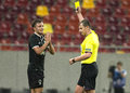 Astra giurgiu omonia nicosia uefa europa league the russian referee maxim layushkin r shows a yellow card to s lukasz gikiewicz l Royalty Free Stock Photo