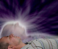 Astral projection man lying down in meditative state experiencing Stock Photos