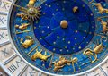 Astrological signs on ancient clock Torre dell`Orologio, Venice, Italy. Medieval Zodiac wheel and constellations